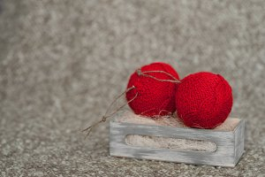 Christmas ball on wool background. Winter decoration.