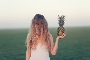 Portrait of woman with pineapple
