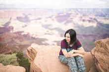 Happy girl in Grand Canyon. Young mu