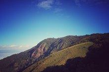 Sky , cloud , tree and mountain