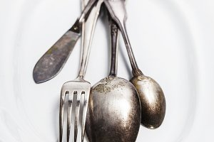 Vintage silverware on a plate