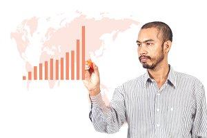 Business man writing graph with worldmap.jpg