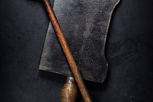 old wooden spoon and Meat cleaver kn