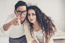 Young couple, man pointing at you
