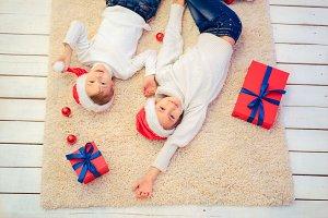 Two children in Santa hat