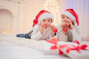 Two children in Santa hat