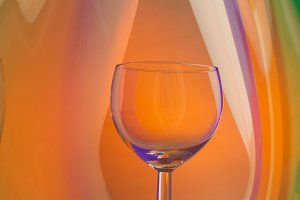 Wine glass on an abstract colored ba