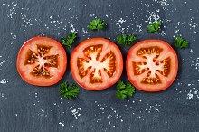 Freshly Sliced Tomatoes on Stone