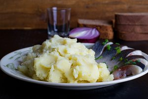 a plate potatoes and herring