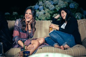 Happy women friends laughing