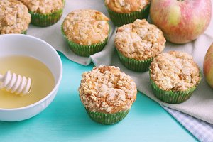 Apple muffins on green pastel table