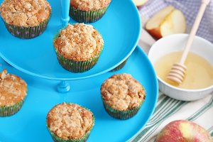 Apple muffins on blue stand