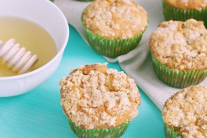 Apple muffins on green pastel