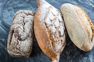 Whole grain breads on the dark woode