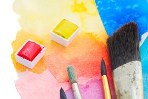 brushes and watercolor paints