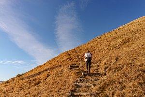 Man running across the hills