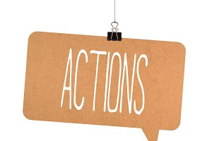 Actions word on cardboard