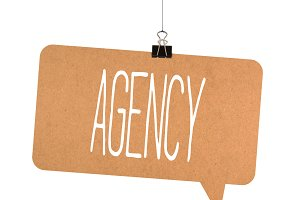 Agency word on cardboard