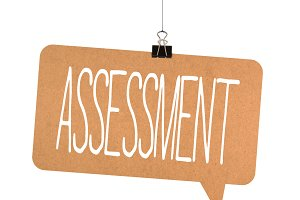 Assessment word on cardboard