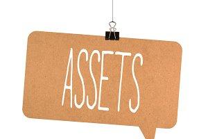Assets word on cardboard