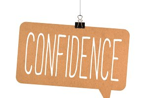 Confidence word on cardboard