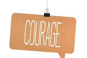 Courage word on cardboard