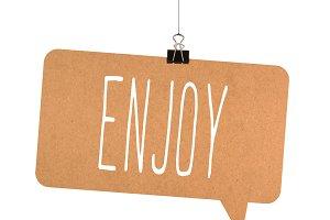 Enjoy word on cardboard