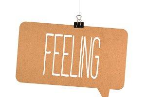 Feeling word on cardboard