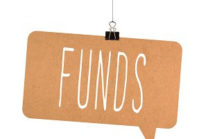 Funds word on cardboard
