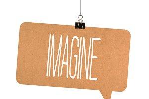 Imagine word on cardboard