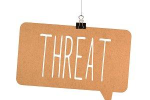 Threat word on cardboard