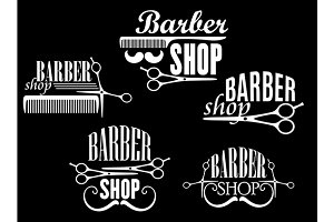 Vintage barber shop emblems on black