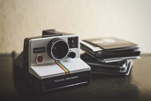 Polaroid Camera & a Stack of Film