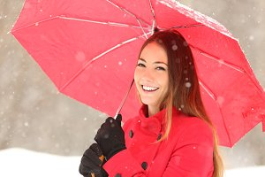 Beauty woman in red with umbrella in winter.jpg