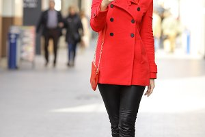 Fashion woman texting a smart phone in winter.jpg