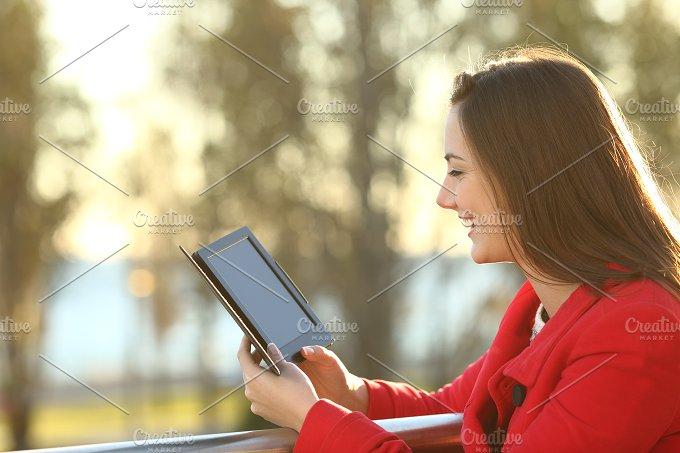Woman reading ebook at sunset.jpg - Technology