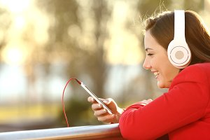 Lady listening music from smart phone.jpg
