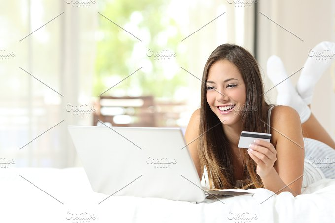 Shopper shopping online with credit card and laptop.jpg - Technology