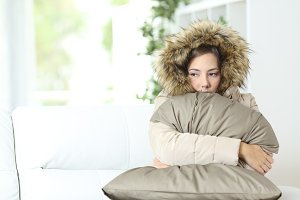 Woman warmly clothed in a cold home.jpg