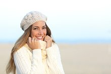 Woman smiling warmly clothed in winter.jpg