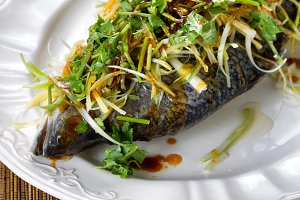 Freshly steamed whole fish on plate