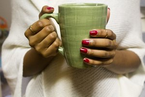 Black Woman Holding Coffee Mug