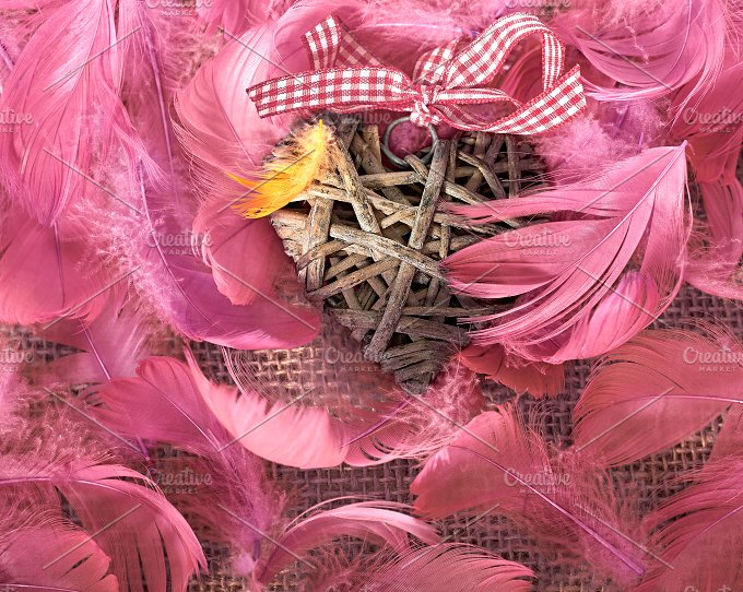 Love, Valentines Day. Heart in feathers on wood - Arts & Entertainment
