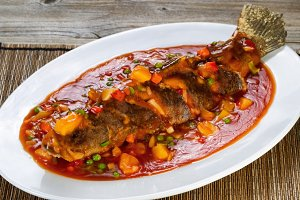 Fried Whole Fish in bowl with sauce