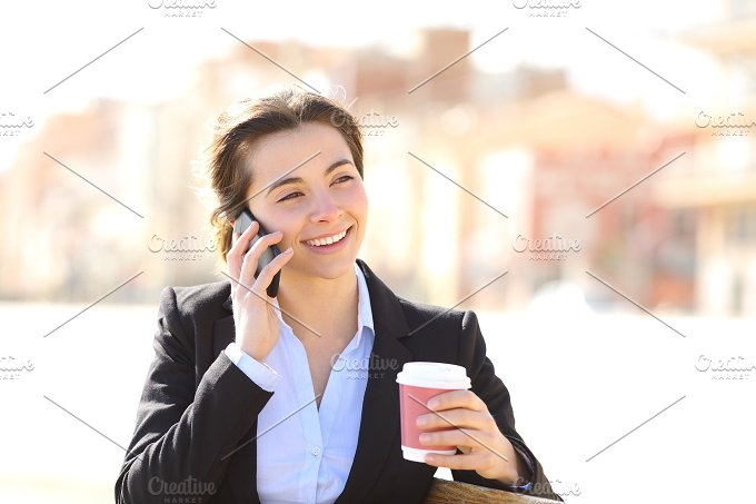 Business woman on the phone in a park.jpg - Business