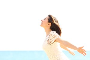 Happy woman enjoying the wind and breathing fresh air.jpg