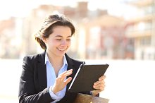 Executive working with a tablet in a park.jpg