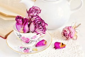 Vintage cup with dry roses