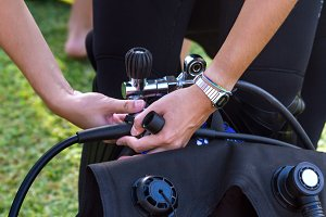A diver preparing his equipment