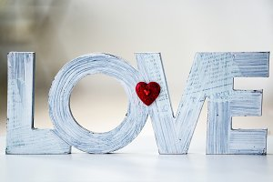 Word Love standing at home
